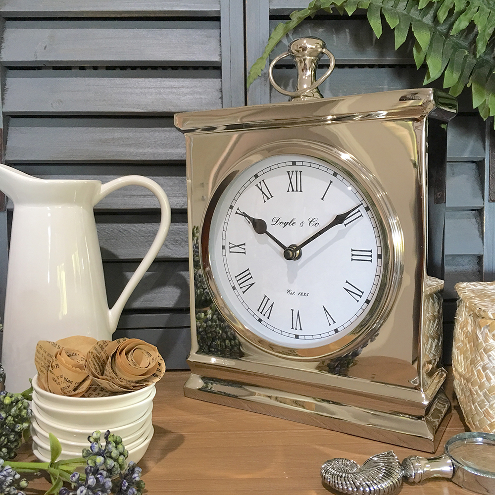 Large polished silver mantle clock humble home